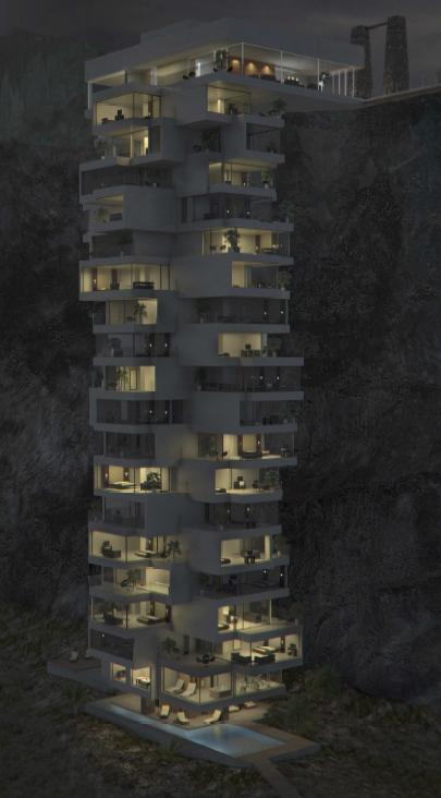 Imagen nocturna del hotel, faro guiando hacia una noche de descanso y paz